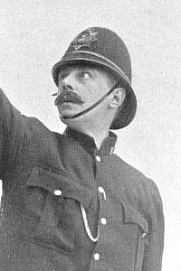 Ernest Torrence as Azuriel, disguised as Policeman Yapp